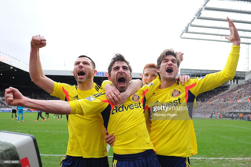 <a gi-track='captionPersonalityLinkClicked' href=/galleries/search?phrase=Fabio+Borini&family=editorial&specificpeople=5565045 ng-click='$event.stopPropagation()'>Fabio Borini</a> (C) of Sunderland celebrates with teammates Phil Bardsley (L) and Marcos Alonso (R) after scoring the opening goal during the Barclays Premier League match between Newcastle United and Sunderland at St James' Park on February 1, 2014 in Newcastle upon Tyne, England.