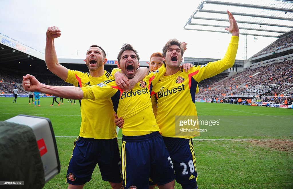 Fabio Borini of Sunderland celebrates with teammates Phil Bardsley and Marcos Alonso after scoring the opening goal during the Barclays Premier...