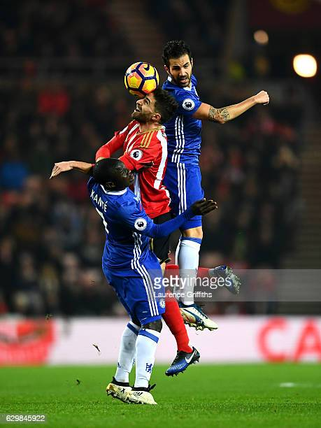 Fabio Borini of Sunderland competes against Cesc Fabregas and N'Golo Kante of Chelsea during the Premier League match between Sunderland and Chelsea...