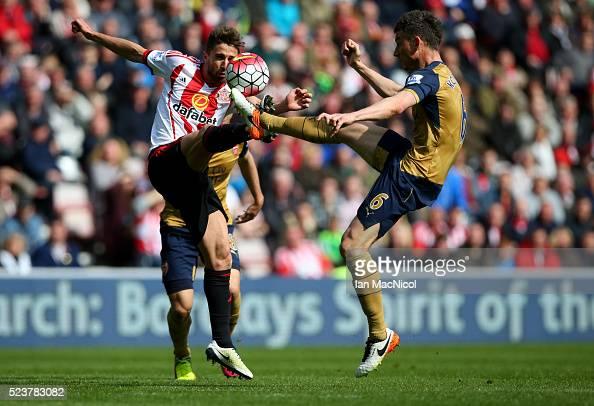 Fabio Borini of Sunderland highkicking with Laurent Koscielny of Arsenal during the Barclays Premier League match between Sunderland and Arsenal at...