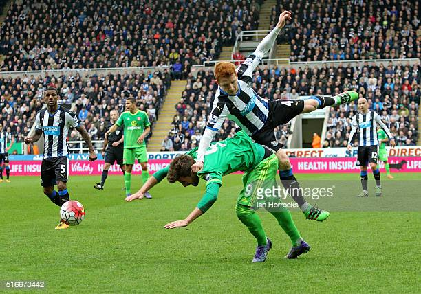 Fabio Borini of Sunderland is fouled by Jack Colback of Newcastle during the Barclays Premier League match between Newcastle United FC and Sunderland...