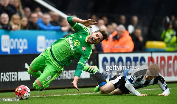 Fabio Borini of Sunderland is fouled by Jack Colback of Newcastle United which earns him a yellow card during the Barclays Premier League match...