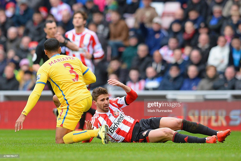 <a gi-track='captionPersonalityLinkClicked' href=/galleries/search?phrase=Fabio+Borini&family=editorial&specificpeople=5565045 ng-click='$event.stopPropagation()'>Fabio Borini</a> of Sunderland reacts after clashing with <a gi-track='captionPersonalityLinkClicked' href=/galleries/search?phrase=Adrian+Mariappa&family=editorial&specificpeople=661604 ng-click='$event.stopPropagation()'>Adrian Mariappa</a> of Crystal Palace during the Barclays Premier League match between Sunderland and Crystal Palace at Stadium of Light on March 15, 2014 in Sunderland, England.