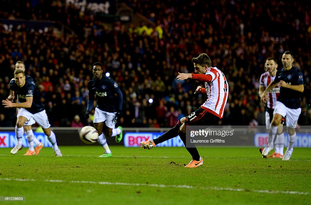 <a gi-track='captionPersonalityLinkClicked' href=/galleries/search?phrase=Fabio+Borini&family=editorial&specificpeople=5565045 ng-click='$event.stopPropagation()'>Fabio Borini</a> of Sunderland scores their second goal from the penalty spot during the Capital One Cup Semi-Final, first leg match between Sunderland and Manchester United at Stadium of Light on January 7, 2014 in Sunderland, England.