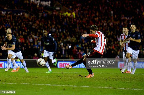 Fabio Borini of Sunderland scores their second goal from the penalty spot during the Capital One Cup SemiFinal first leg match between Sunderland and...