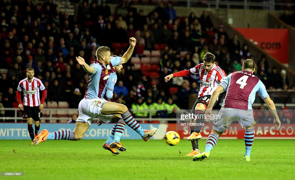 <a gi-track='captionPersonalityLinkClicked' href=/galleries/search?phrase=Fabio+Borini&family=editorial&specificpeople=5565045 ng-click='$event.stopPropagation()'>Fabio Borini</a> of Sunderland shoots but is blocked by the Villa defenders during the Barclays Premier League match between Sunderland and Aston Villa at The Stadium of Light on January 01, 2014 in Sunderland, England.