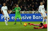 Fabio Borini of Sunderland shoots past Fabianski in the Swansea goal to score the opening goal during the Barclays Premier League Match between...