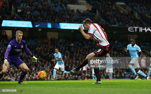 Fabio Borini of Sunderland shoots past Joe Hart of Manchester City to score a goal during the Barclays Premier League match between Manchester City...