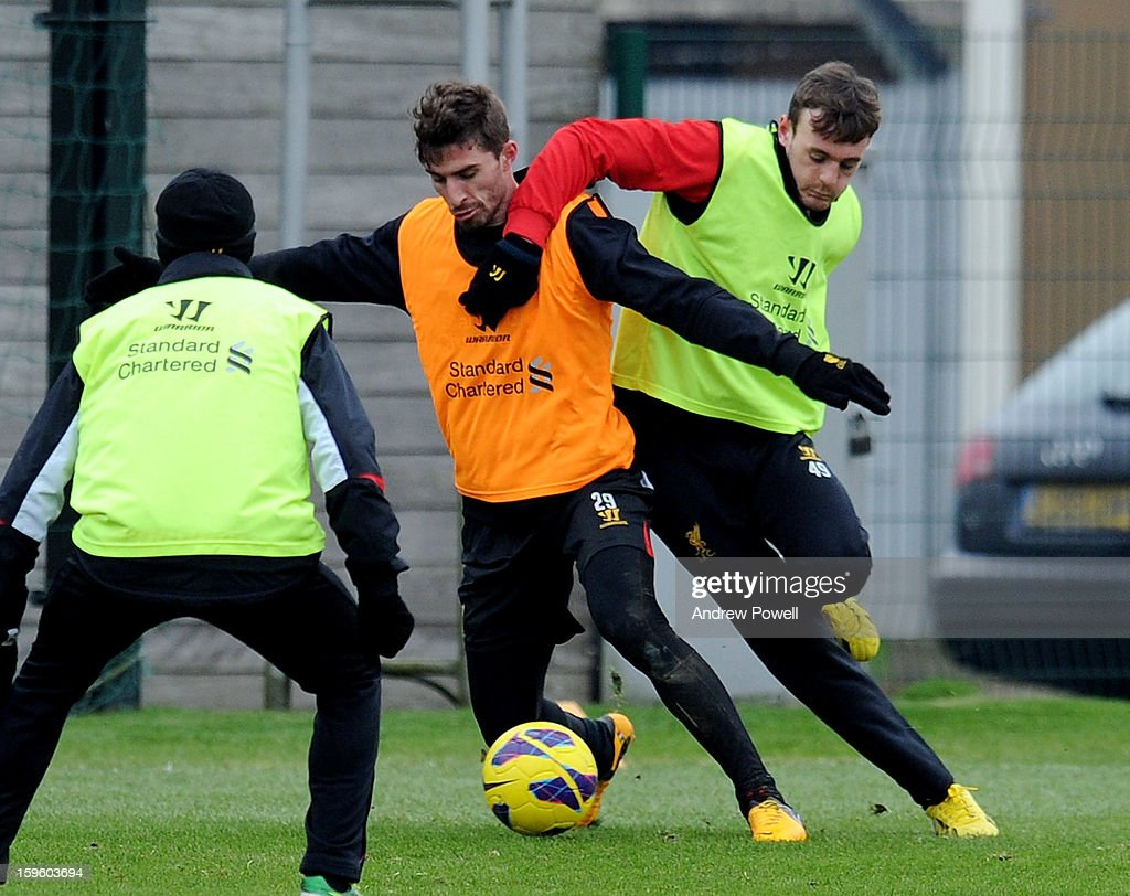 Fabio Borrini and Jack Robinson of Liverpool in action during a training session at Melwood Training Ground on January 17, 2013 in Liverpool, England.