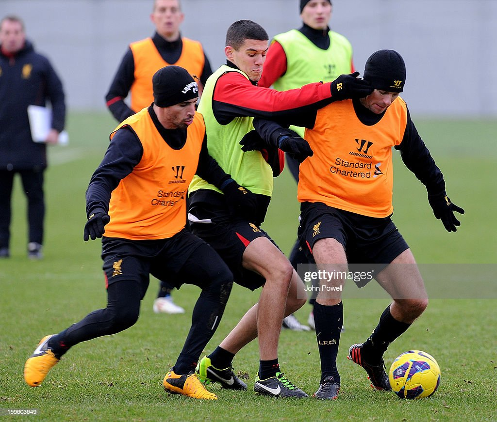 Fabio Borrini and Steven Gerrard compete with Conor Coady of Liverpool during a training session at Melwood Training Ground on January 17, 2013 in Liverpool, England.