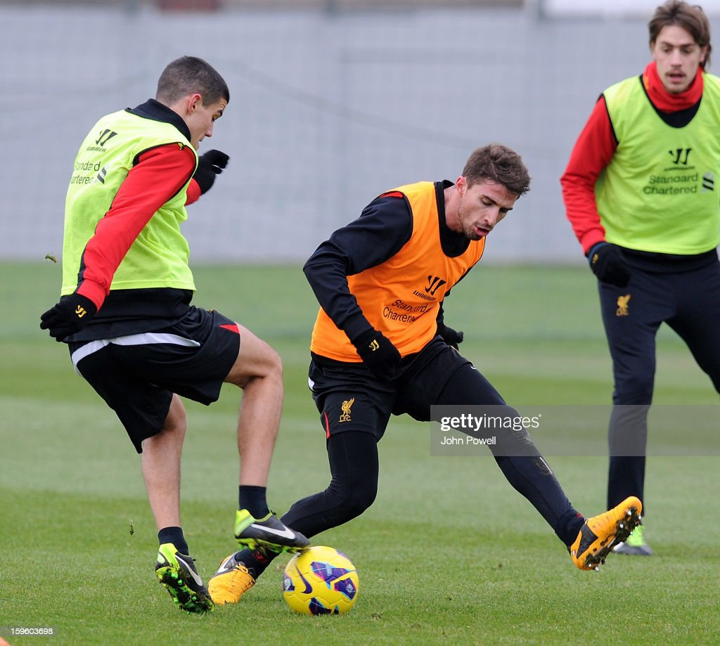 Fabio Borrini competes with Conor Coady of Liverpool during a training session at Melwood Training Ground on January 17, 2013 in Liverpool, England.