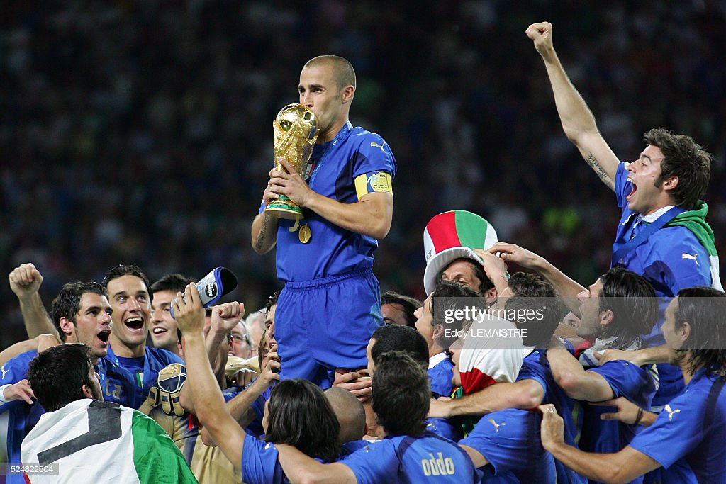 Fabio Cannavaro (Italy) and Italian players celebrate with the winner's trophy after the final of the 2006 FIFA World Cup between Italy and France.