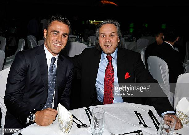 Fabio Cannavaro and Rabah Madjer pose during the Algerian Gold Ball awards ceremony on November 28 2011 in Algiers Algeria