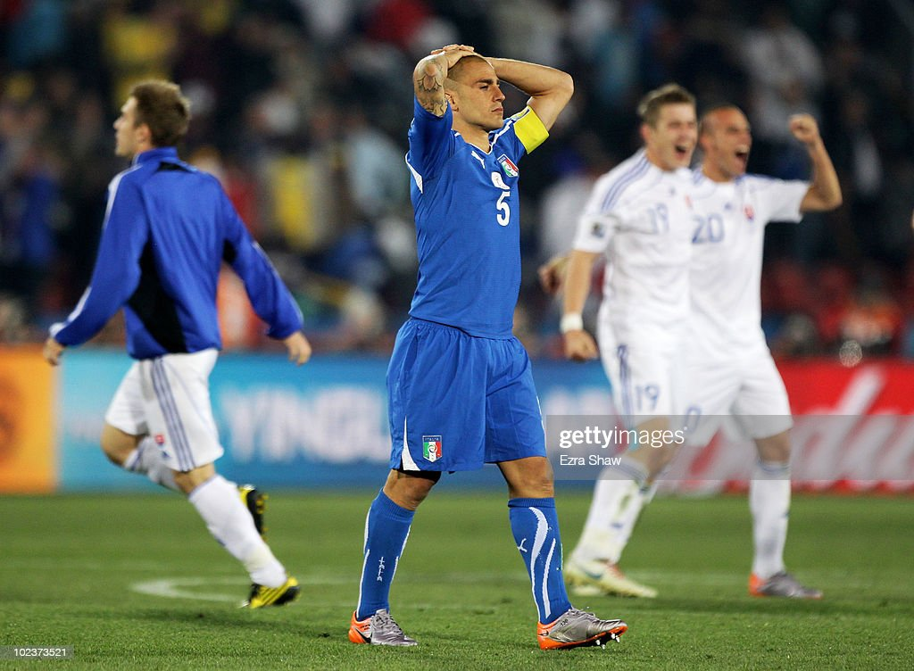 <a gi-track='captionPersonalityLinkClicked' href=/galleries/search?phrase=Fabio+Cannavaro&family=editorial&specificpeople=204335 ng-click='$event.stopPropagation()'>Fabio Cannavaro</a>, captain of Italy, leaves the field dejected after being knocked out of the competition by Slovakia during the 2010 FIFA World Cup South Africa Group F match between Slovakia and Italy at Ellis Park Stadium on June 24, 2010 in Johannesburg, South Africa.
