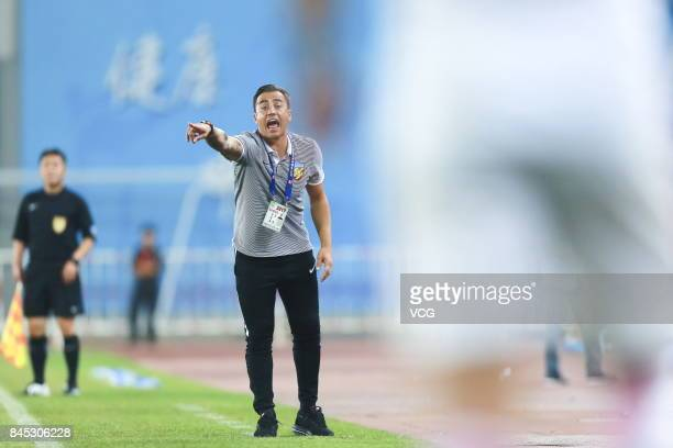 Fabio Cannavaro head coach of Tianjin Quanjian speaks to his players during the 24th round match of 2017 Chinese Football Association Super League...