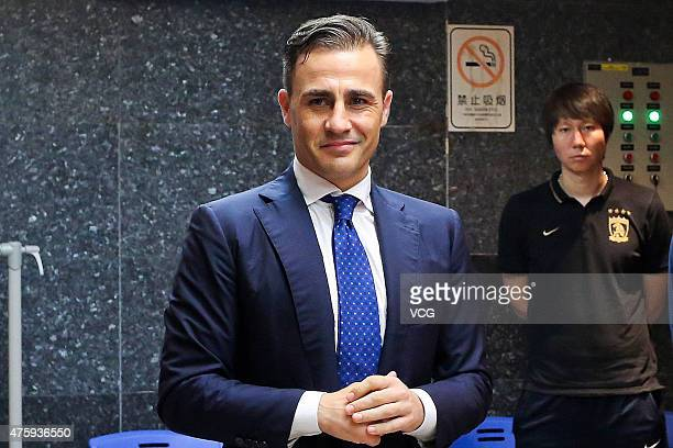 Fabio Cannavaro Italy's World Cup winning captain and chief coach of Guangzhou Evergrande Taobao Football Club says farewells with members of...