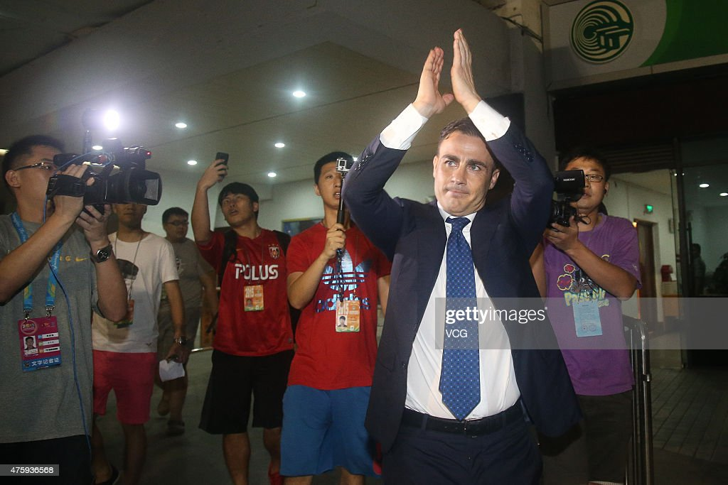 <a gi-track='captionPersonalityLinkClicked' href=/galleries/search?phrase=Fabio+Cannavaro&family=editorial&specificpeople=204335 ng-click='$event.stopPropagation()'>Fabio Cannavaro</a>, Italy's World Cup winning captain and chief coach of Guangzhou Evergrande Taobao Football Club, says farewells with football fans after the match between Guangzhou Evergrande vs Tianjin Teda F.C. on June 4, 2015 in Guangzhou, Guangdong province of China. Former Brazil head coach Luiz Felipe Scolari would replace <a gi-track='captionPersonalityLinkClicked' href=/galleries/search?phrase=Fabio+Cannavaro&family=editorial&specificpeople=204335 ng-click='$event.stopPropagation()'>Fabio Cannavaro</a> as new coach of Guangzhou Evergrande Taobao Football Club for two and a half years.