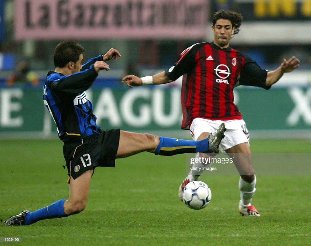 Fabio Cannavaro of Inter Milan challenges Manuel Rui Costa of AC