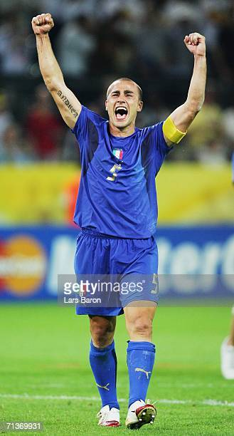 Fabio Cannavaro of Italy celebrates his team's victory at the end of the FIFA World Cup Germany 2006 Semifinal match between Germany and Italy played...