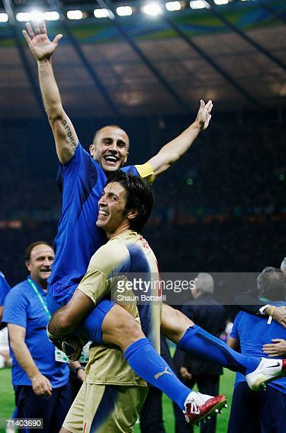 Fabio Cannavaro of Italy celebrates his team's victory in a penalty shootout with Goalkeeper Gianluigi Buffon at the end of the FIFA World Cup...