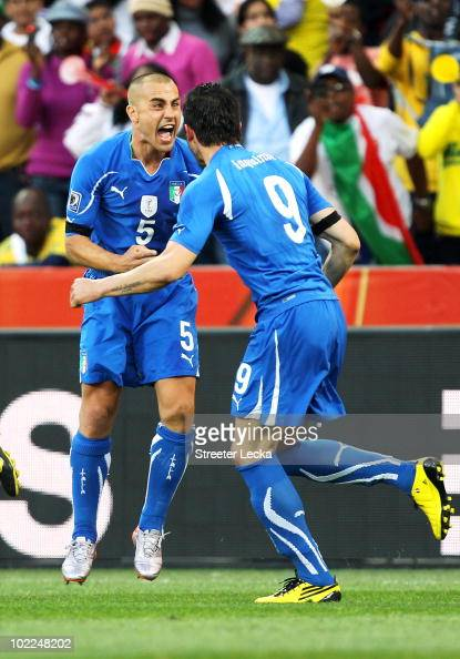 Fabio Cannavaro of Italy celebrates with goalscorer Vincenzo Iaquinta of Italy after he scores from the penalty spot during the 2010 FIFA World Cup...