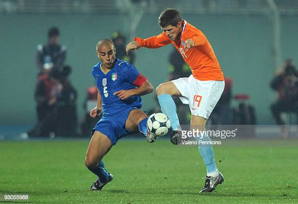 Fabio Cannavaro of Italy challenges for the ball with KlaasJan Huntelaar of Holland during the international friendly match between Italy and Holland...