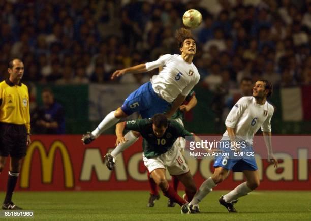 Fabio Cannavaro of Italy gets above Mexico's Cuauhtemoc Blanco to head the ball
