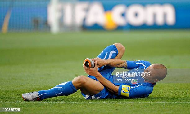 Fabio Cannavaro of Italy holds his foot after being tackled during the 2010 FIFA World Cup South Africa Group F match between Slovakia and Italy at...