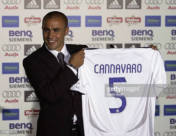 Fabio Cannavaro of Italy holds up his team shirt during his official presentation as a new Real Madrid signing at the Santiago Bernabeu stadium on...