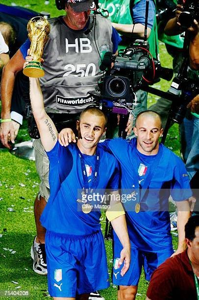 Fabio Cannavaro of Italy lifts the World Cup trophy aloft following his team's victory in a penalty shootout at the end of the FIFA World Cup Germany...