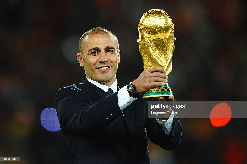 <a gi-track='captionPersonalityLinkClicked' href=/galleries/search?phrase=Fabio+Cannavaro&family=editorial&specificpeople=204335 ng-click='$event.stopPropagation()'>Fabio Cannavaro</a> of Italy presents the World Cup trophy prior to the 2010 FIFA World Cup South Africa Final match between Netherlands and Spain at Soccer City Stadium on July 11, 2010 in Johannesburg, South Africa.