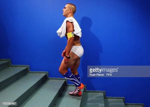 Fabio Cannavaro of Italy shows his dejection as he walks up the stairs to the dressing room after the 2010 FIFA World Cup South Africa Group F match...