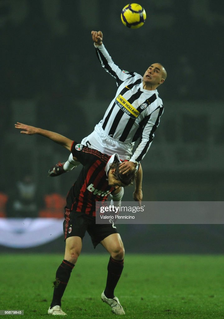 Fabio Cannavaro of Juventus FC clashes with Massimo Ambrosini of AC Milan during the Serie A match between Juventus FC and AC Milan at Stadio Olimpico di Torino on January 10, 2010 in Turin, Italy.