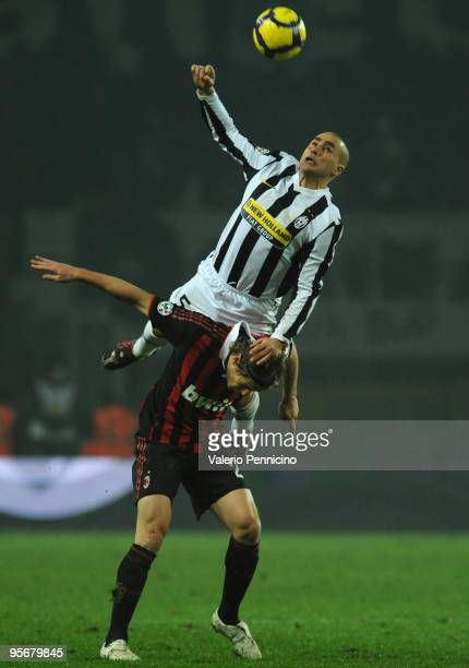 Fabio Cannavaro of Juventus FC clashes with Massimo Ambrosini of AC Milan during the Serie A match between Juventus FC and AC Milan at Stadio...