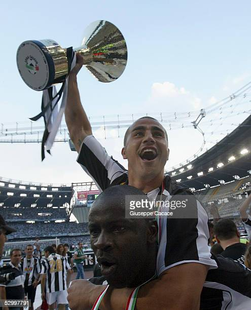 Fabio Cannavaro of Juventus holds the trophy for the victory of 'Scudetto' at the end of the last Serie A football match of the season between...