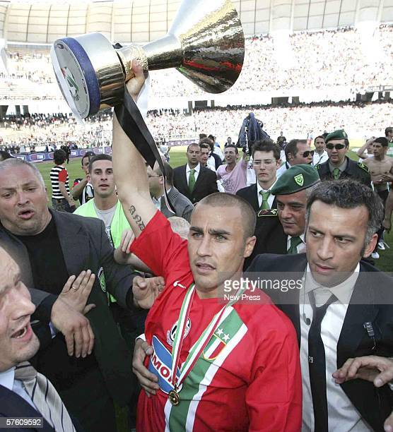 Fabio Cannavaro of Juventus holds up the title trophy after the Serie A match between Reggina and Juventus at the Stadio Granillo on May 14 2006 in...