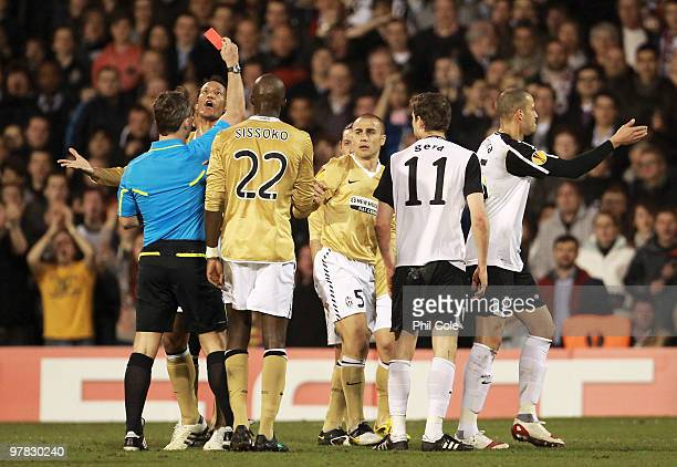 Fabio Cannavaro of Juventus is shown the red card by referee Bjorn Kuipers during the UEFA Europa League Round of 16 second leg match between Fulham...
