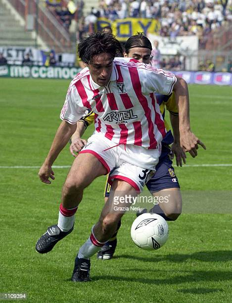 Fabio Cannavaro of Parma and Luca Toni of Vicenza in action during the Serie A 28th Round League match between Vicenza and Parma played at the Romeo...