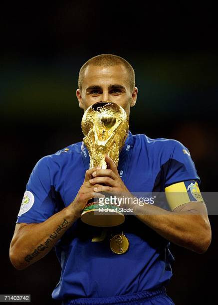 Fabio Cannavaro the captain of Italy prepares to lift the world cup trophy after his team's victory during the FIFA World Cup Germany 2006 Final...