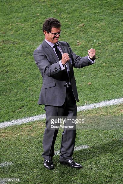 Fabio Capello manager of England celebrates victory following the 2010 FIFA World Cup South Africa Group C match between Slovenia and England at the...