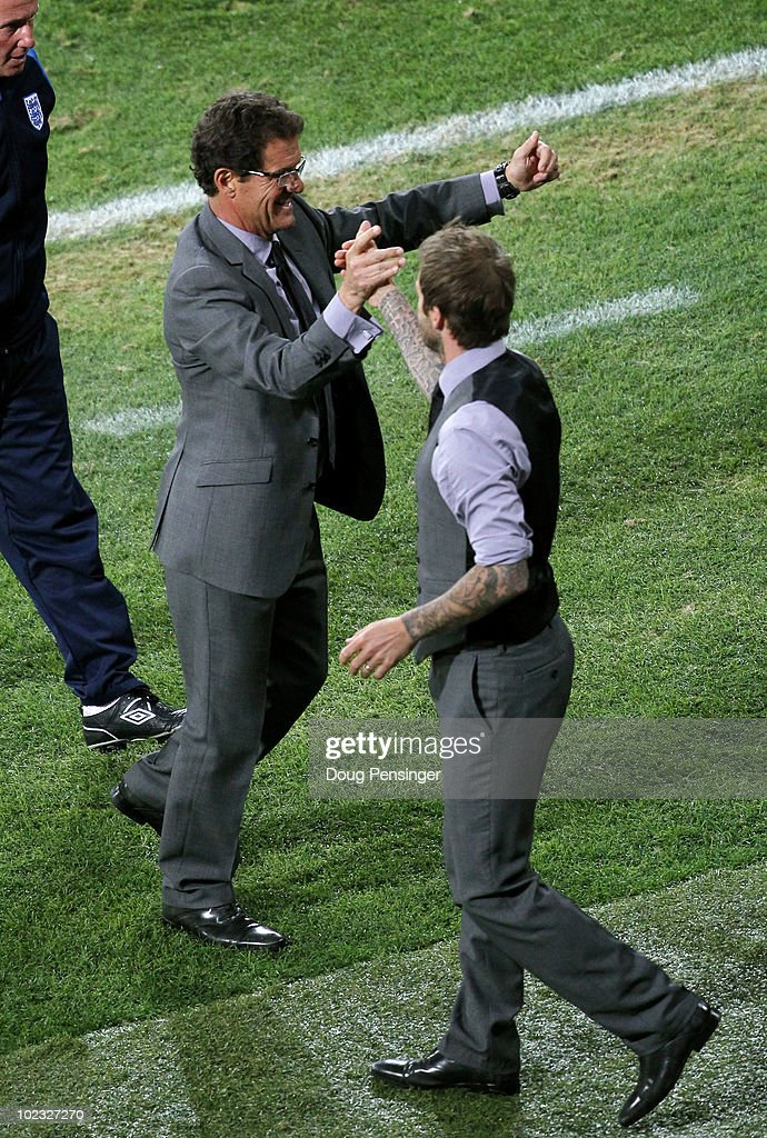 <a gi-track='captionPersonalityLinkClicked' href=/galleries/search?phrase=Fabio+Capello&family=editorial&specificpeople=241290 ng-click='$event.stopPropagation()'>Fabio Capello</a> manager of England celebrates victory with <a gi-track='captionPersonalityLinkClicked' href=/galleries/search?phrase=David+Beckham&family=editorial&specificpeople=158480 ng-click='$event.stopPropagation()'>David Beckham</a> following the 2010 FIFA World Cup South Africa Group C match between Slovenia and England at the Nelson Mandela Bay Stadium on June 23, 2010 in Port Elizabeth, South Africa.