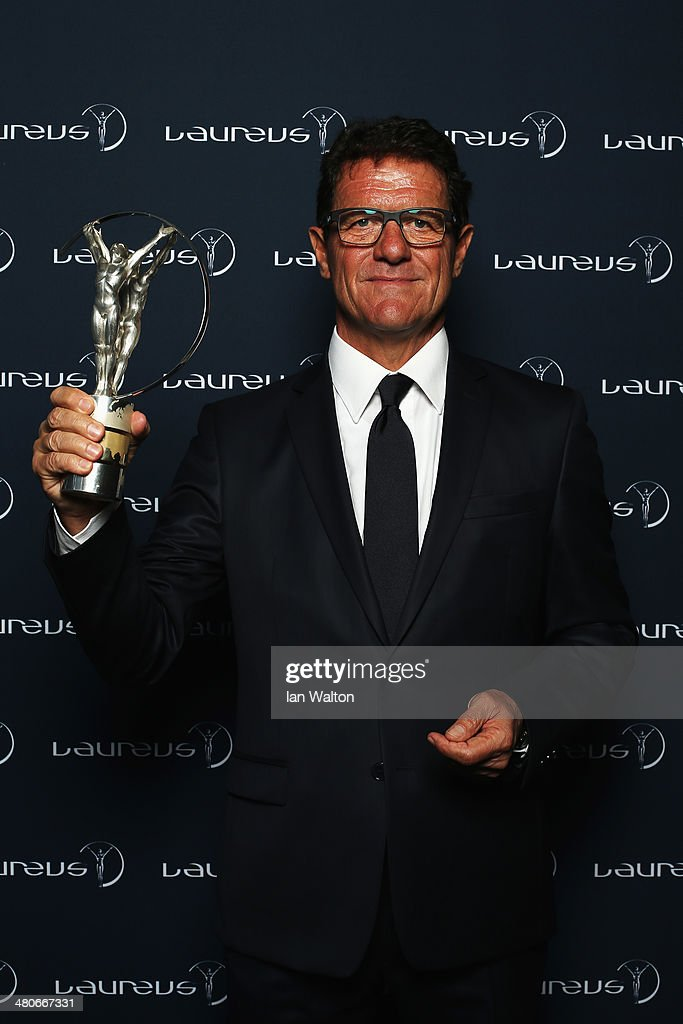 <a gi-track='captionPersonalityLinkClicked' href=/galleries/search?phrase=Fabio+Capello&family=editorial&specificpeople=241290 ng-click='$event.stopPropagation()'>Fabio Capello</a> poses with the trophy during the 2014 Laureus World Sports Awards at the Istana Budaya Theatre on March 26, 2014 in Kuala Lumpur, Malaysia.