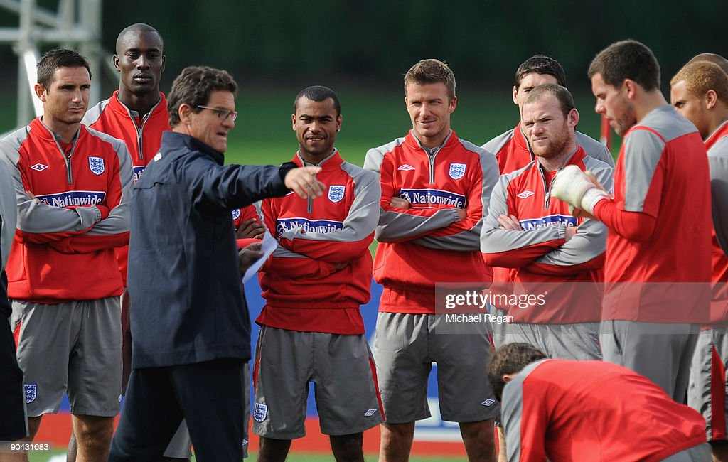 Fabio Capello talks to Frank Lampard, Carlton Cole, Ashley Cole, David Beckham, Wayne Rooney and the rest of the squad during the England training session at London Colney on September 8, 2009 in St Albans, England.