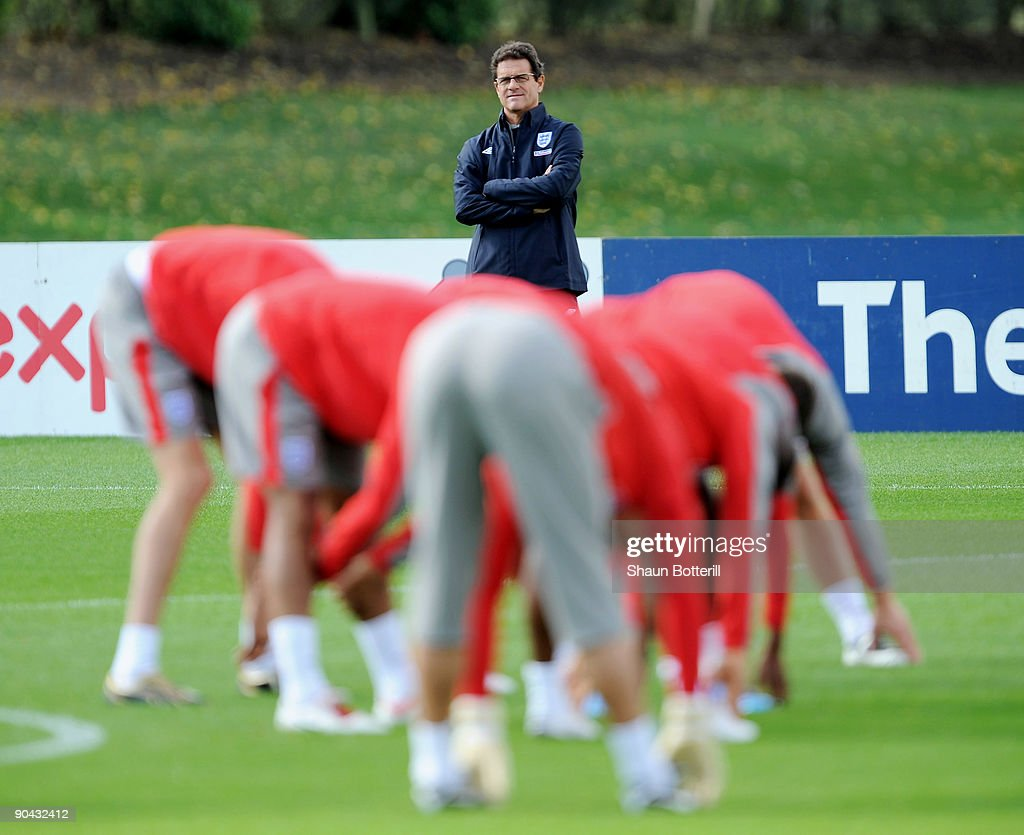 Fabio Capello the England manager watches his players during training at London Colney on September 8, 2009 in St Albans, England.