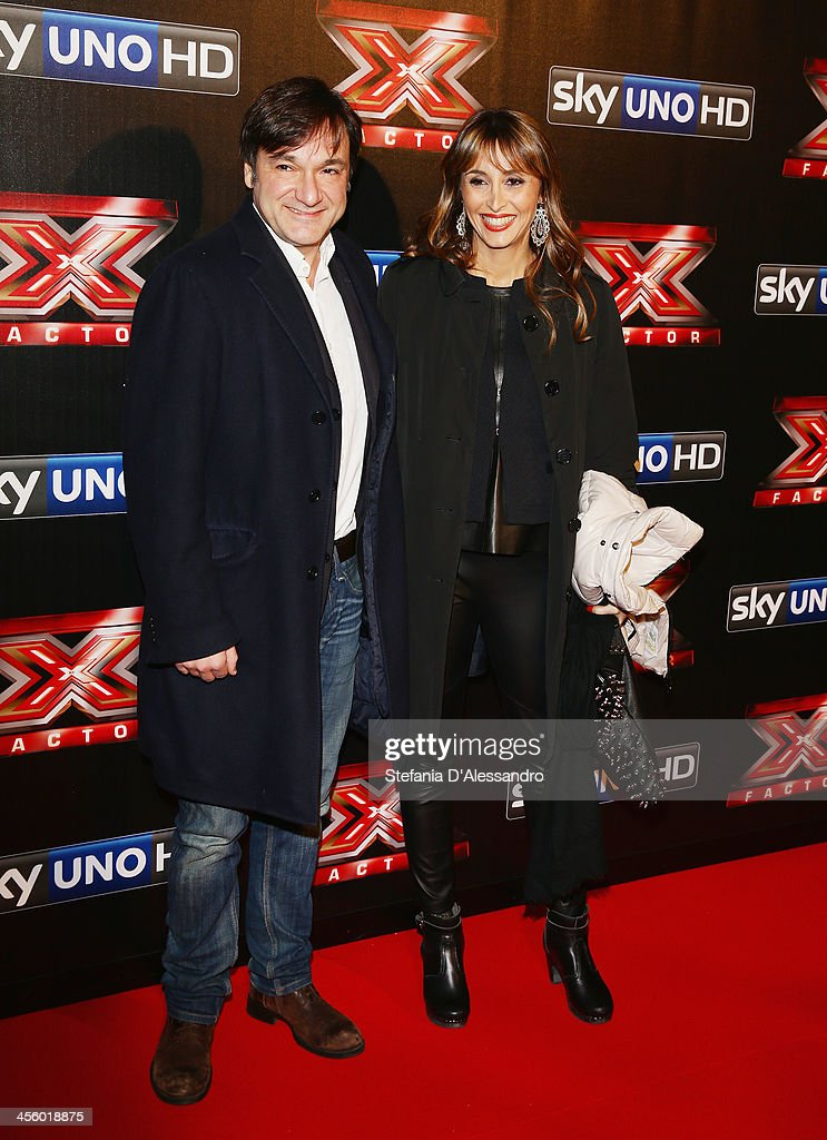 Fabio Caressa (L) and Benedetta Parodi (R) attend 'X Factor 2013 - The Final' Red Carpet on December 12, 2013 in Milan, Italy.