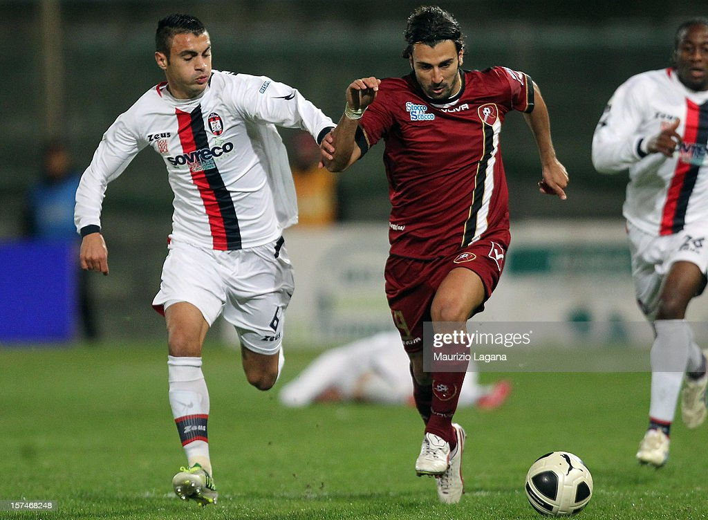 Fabio Ceravolo (R) of Reggina competes for the ball with Mirko Eramo of Crotone during the Serie B match between Reggina Calcio and FC Crotone at Stadio Oreste Granillo on December 3, 2012 in Reggio Calabria, Italy.