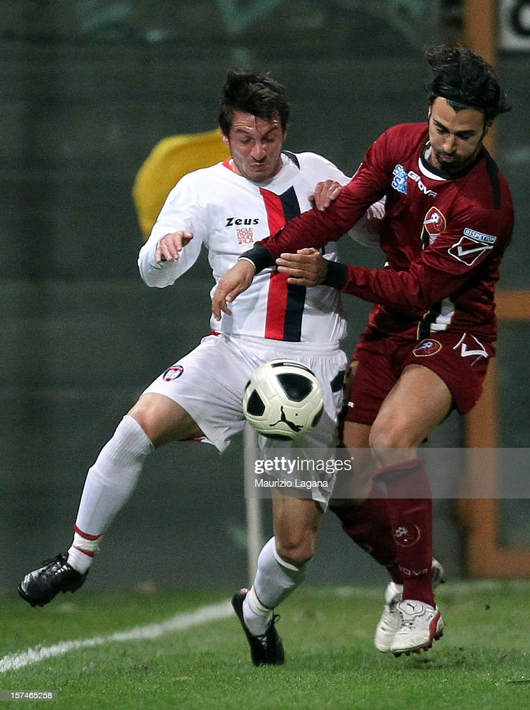 Fabio Ceravolo (R) of Reggina competes for the ball with Pietro De Giorgio of Crotone during the Serie B match between Reggina Calcio and FC Crotone at Stadio Oreste Granillo on December 3, 2012 in Reggio Calabria, Italy.