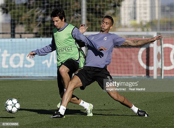 Fabio Coentrao and Danilo of Real Madrid in action during a training session at Valdebebas training ground on December 6 2016 in Madrid Spain
