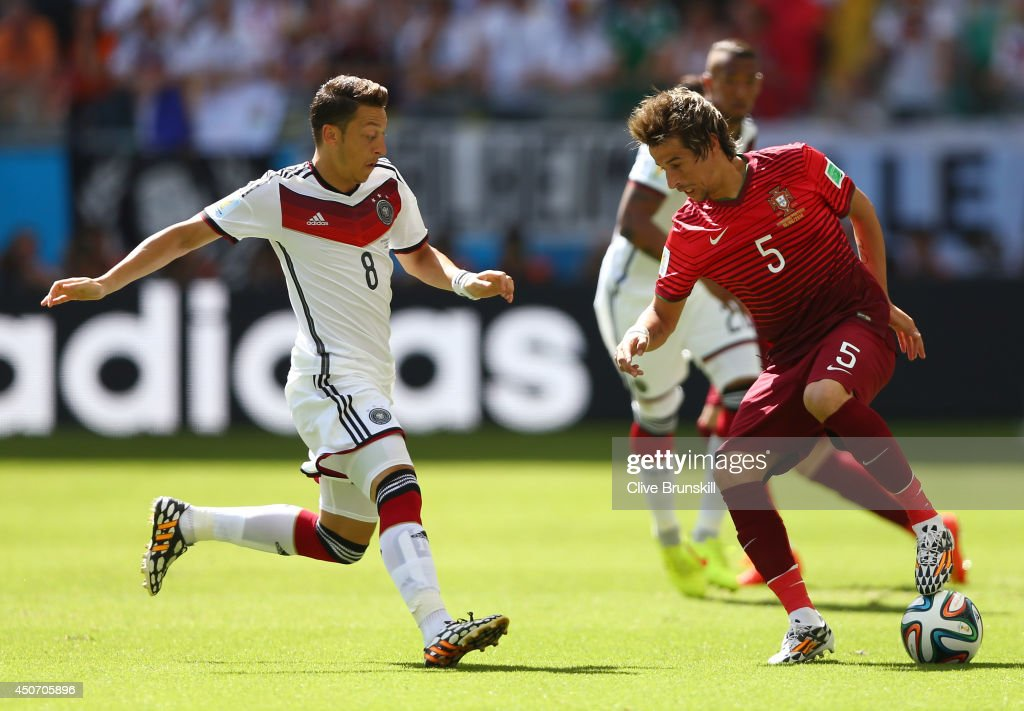 Fabio Coentrao of Portugal controls the ball against <a gi-track='captionPersonalityLinkClicked' href=/galleries/search?phrase=Mesut+Oezil&family=editorial&specificpeople=764075 ng-click='$event.stopPropagation()'>Mesut Oezil</a> of Germany during the 2014 FIFA World Cup Brazil Group G match between Germany and Portugal at Arena Fonte Nova on June 16, 2014 in Salvador, Brazil.