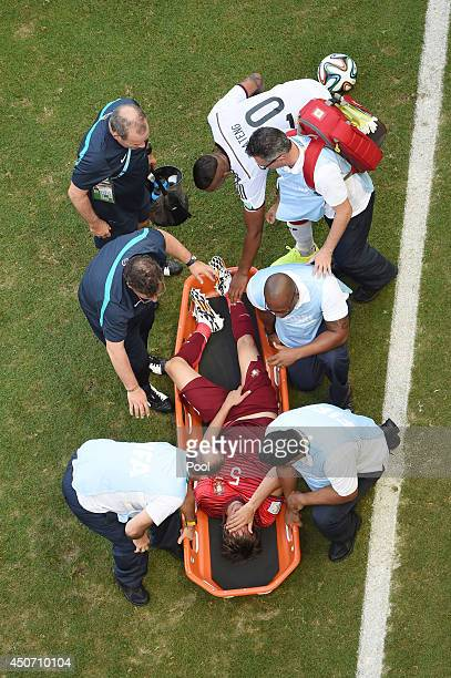Fabio Coentrao of Portugal is stretchered off the field after an injury during the 2014 FIFA World Cup Brazil Group G match between Germany and...